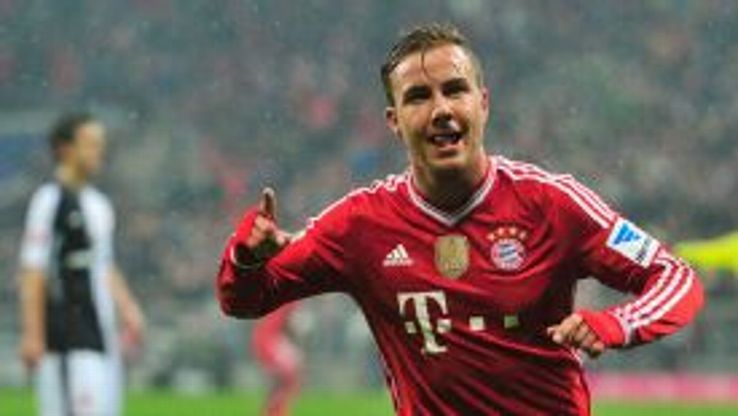 Mario Goetze celebrates giving Bayern the early lead against Eintracht Frankfurt.