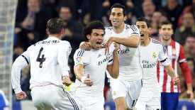 Pepe leads the celebrations after his shot deflected off Emiliano Insua to give Madrid the lead against Atletico.