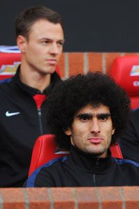 Jonny Evans and Marouane Fellaini bench