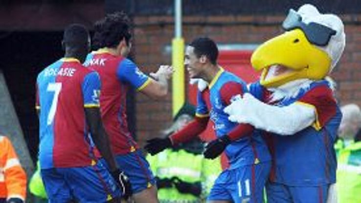 Pete the Eagle embraces Tom Ince after he scored on his debut for Crystal Palace against West Brom.
