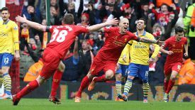 Martin Skrtel wheels away after his header made it 2-0 against Arsenal.
