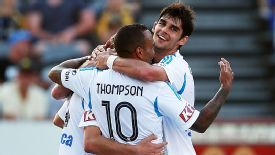 Melbourne Victory celebrate after one of James Troisi's two goals.