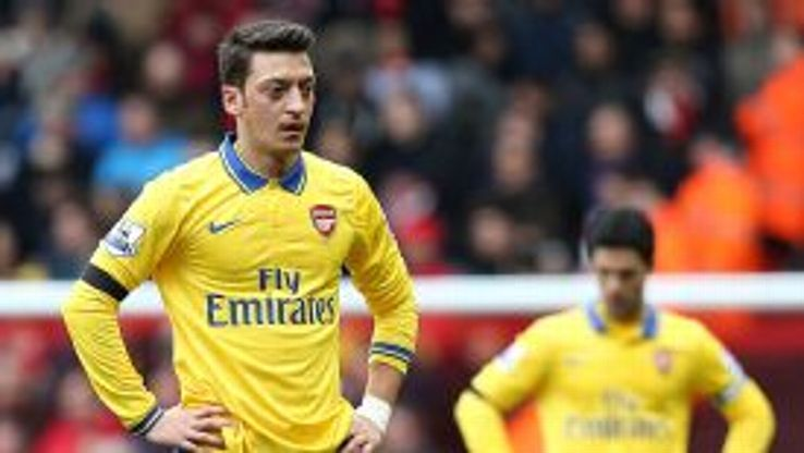 Mesut Ozil reacts to Arsenal's woeful beginning against Liverpool.