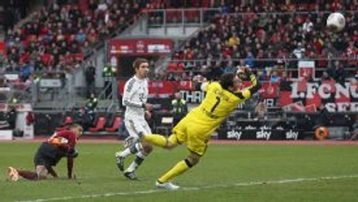 Philipp Lahm scores Bayern's second in their 2-0 win at Nurnberg.