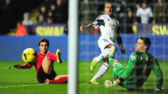 Wayne Routledge curls home to get Swansea City on their way to a derby day rout of Cardiff.City.