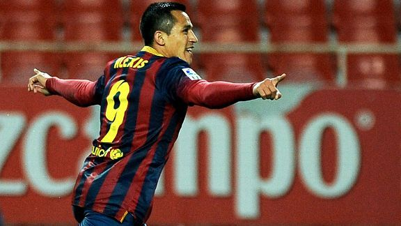 Alexis Sanchez celebrates after scoring Barcelona's leveller at Sevilla.