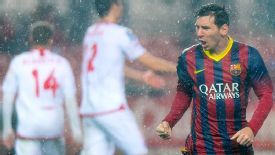 Lionel Messi celebrates in the rain after scoring his first goal at Sevilla.