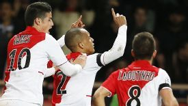 Monaco celebrate after a cross by Fabinho (c) was turned into his own net by Thiago Silva.