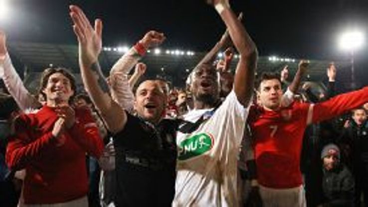 Cannes players celebrate with their fans after they knocked Montpellier out of the French Cup.