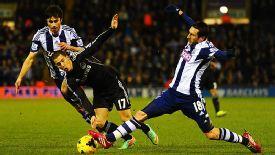 Eden Hazard battles with Morgan Amalfitano.