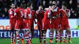 Jose Fonte is mobbed after forcing home Southampton's winner at Hull.