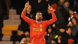 Daniel Sturridge celebrates after bringing Liverpool back on level terms at Fulham.