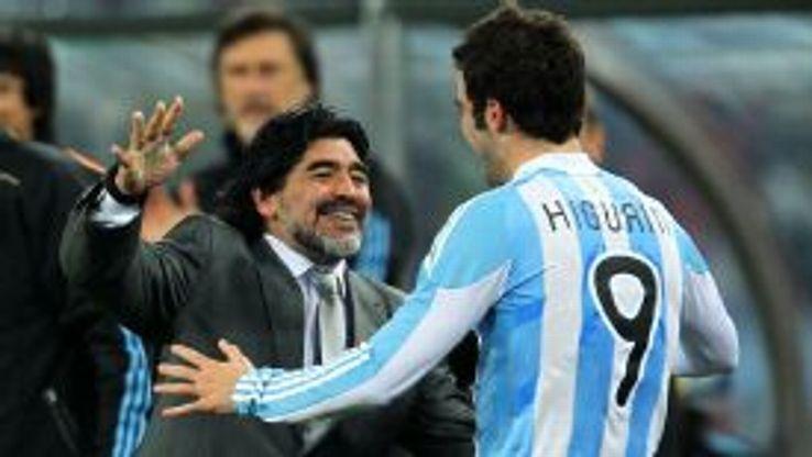 Gonzalo Higuain and Diego Maradona embrace