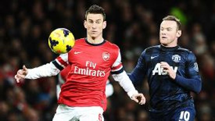 Laurent Koscielny holds off Wayne Rooney.