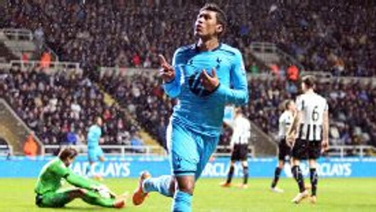 Paulinho celebrates after doubling Spurs' advantage at Newcastle.
