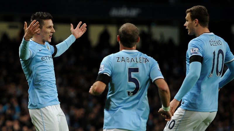 Stevan Jovetic celebrates his early strike with Pablo Zabaleta and Edin Dzeko.