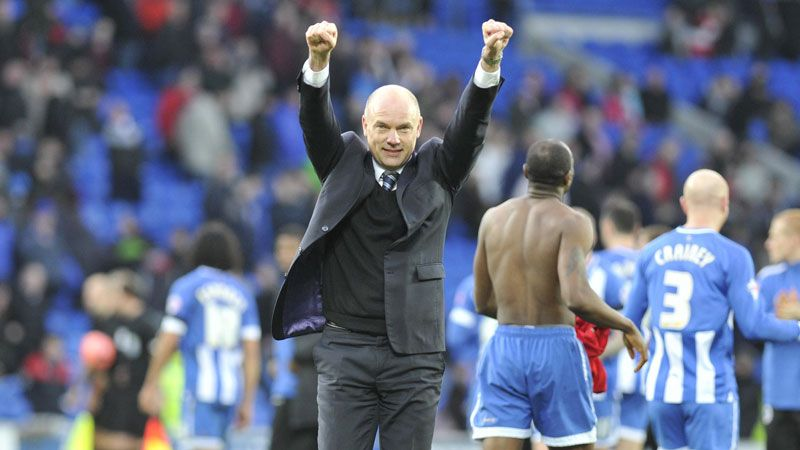 Wigan boss Uwe Rosler celebrates the 2-1 victory at the Cardiff City Stadium.