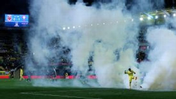 Villarreal's Jonathan Pereira kicks the smoke bomb, which held up play for 20 minutes.