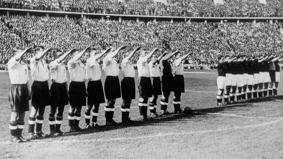 England controversially perform the Nazi salute in 1938.
