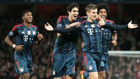 Javi Martinez celebrates with goalscorer Toni Kroos after he netted a stunning goal at Arsenal.