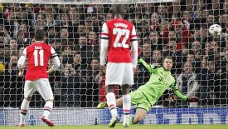 Manuel Neuer saves Mesut Ozil's penalty kick.