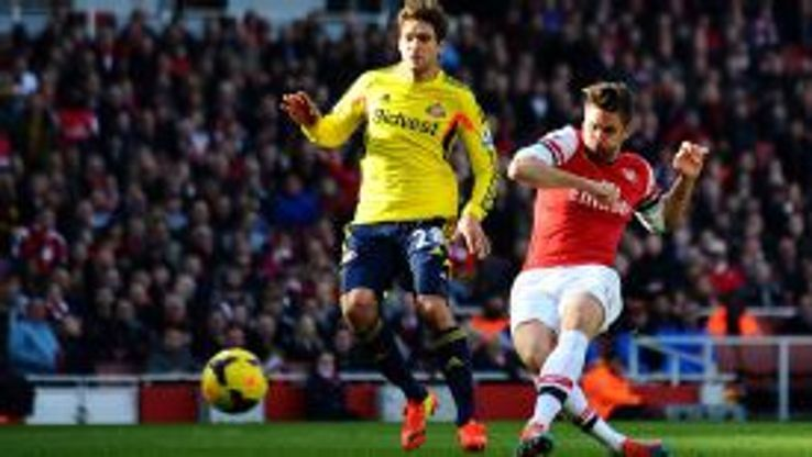 Arsenal's Olivier Giroud (right) scores his sides first goal of the game.