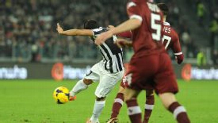 Carlos Tevez strikes the ball home for the opening goal.