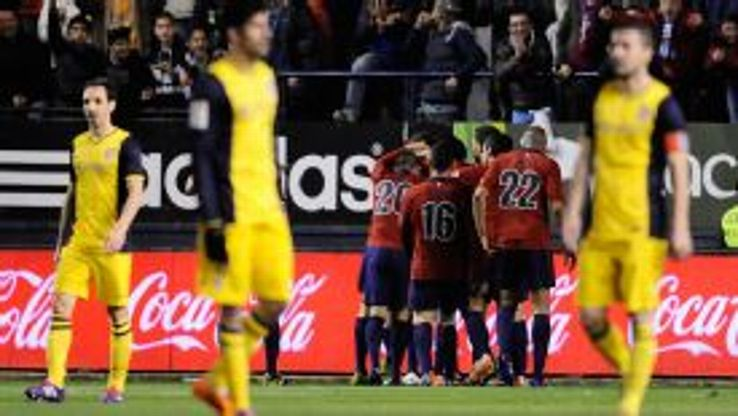 Osasuna's players celebrate their second goal after scoring against Atletico Madrid