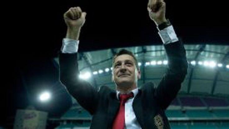 Bula salutes fans after Gibraltar's international debut against Slovakia.