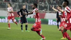Joel Campbell wheels away in delight after scoring Olympiakos' second goal.
