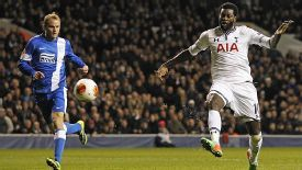 Emmanuel Adebayor scores Spurs' crucial third goal against Dnipro.