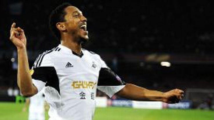 Jonathan De Guzman celebrates after bringing Swansea back on level terms at Napoli.
