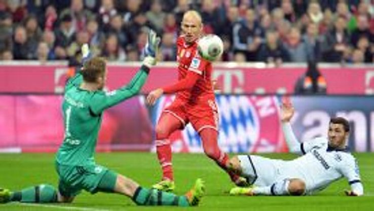 Arjen Robben scores Bayern's second goal in their rout of Schalke.