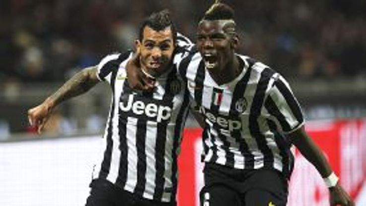 Goalscorer Carlos Tevez celebrates with Paul Pogba in the win at Milan.