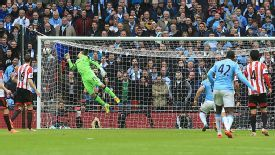 Vito Mannone is helpless to prevent Yaya Toure's stunning strike from finding the top corner to bring Man City level.