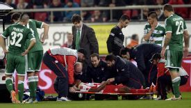 Michael Olaitan collapsed in the first half of the Athens derby.