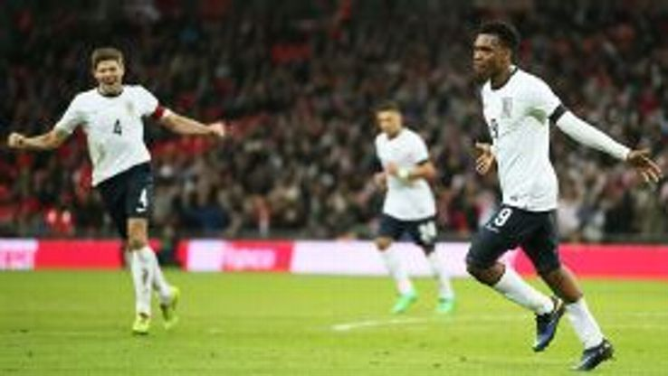 Steven Gerrard celebrates after Liverpool teammate Daniel Sturridge scored England's winner against Denmark.
