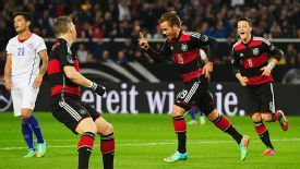 Germany celebrate Mario Goetze's winner against Chile.