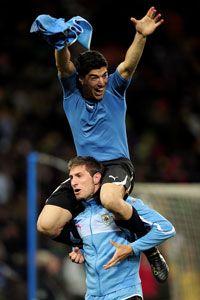 Luis Suarez celebrates Uruguay's victory over Ghana.