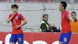 Kim Shin-wook joins goalscorer Son Heung-min (l) in celebration in the win against Greece.