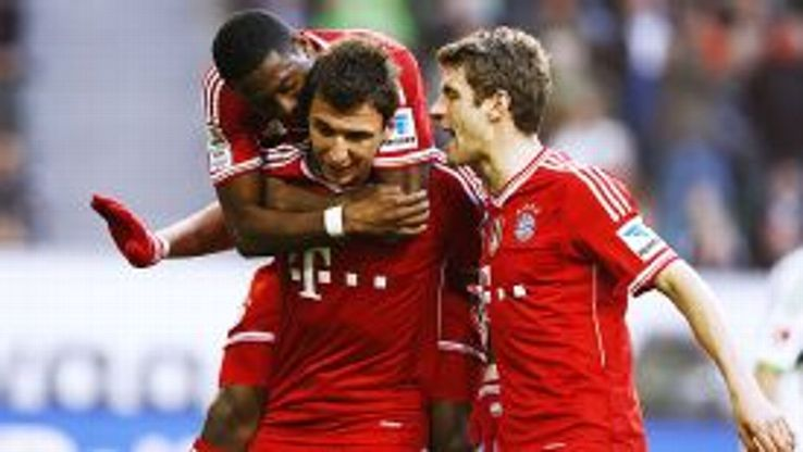 Mario Mandzukic and Thomas Mueller both scored twice in Bayern's 6-1 rout of Wolfsburg.