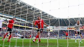 Steven Caulker puts Cardiff in front against Fulham.