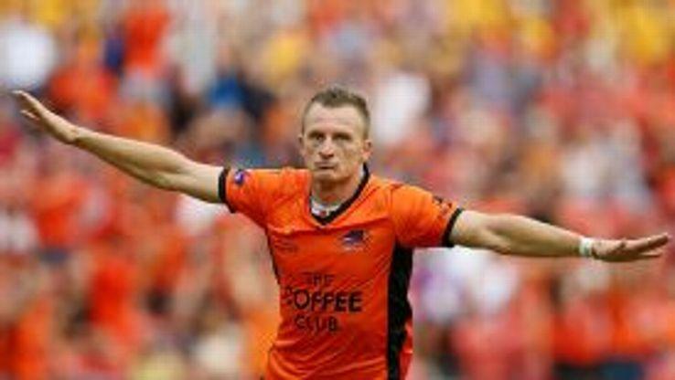 Besart Berisha struck twice for Brisbne Roar against Adelaide United.