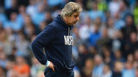Manuel Pellegrini struggles to hide his frustration as it all goes wrong for City against Wigan in the FA Cup.