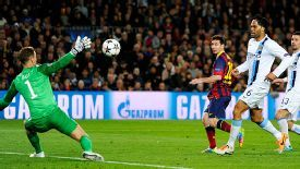 Lionel Messi lits the ball over Joe Hart to give Barcelona the lead.