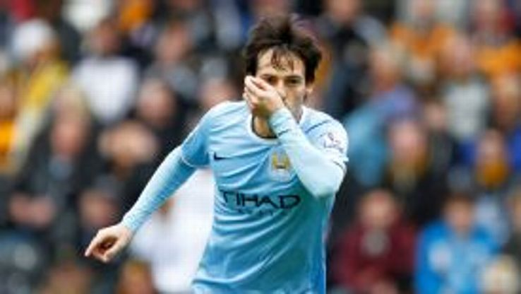 David Silva wheels away after scoring a fine goal at Hull.