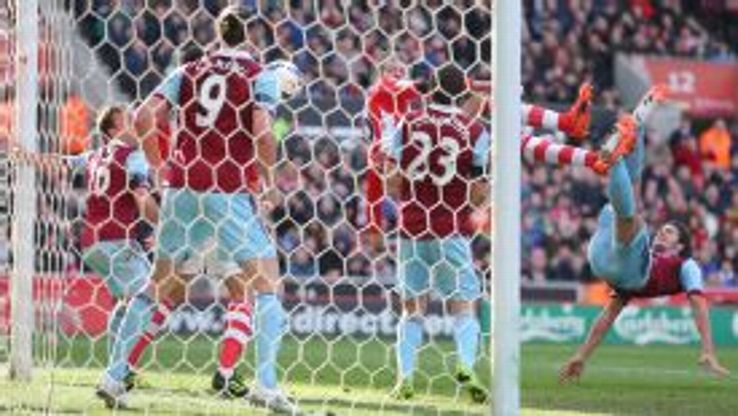Stoke City's Peter Crouch levels against West Ham.