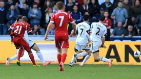 West Bromwich Albion's Youssouf Mulumbu (left) shoots to score his team's second goal