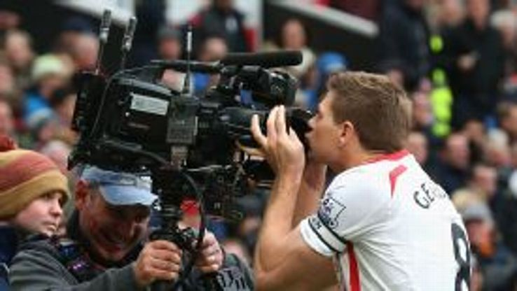 Steven Gerrard kisses the camera after scoring his second penalty.