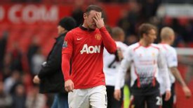 Wayne Rooney appears dejected at the final whistle.